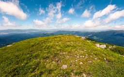 Grassy slopes of mountain ridge in afternoon. Grassy slopes and boulders of mountain ridge in afternoon. beautiful summer scenery of the Runa mountain of Royalty Free Stock Image