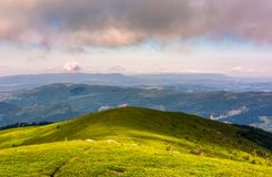 Grassy slopes of mountain ridge in afternoon. Grassy slopes and boulders of mountain ridge in afternoon. beautiful summer scenery of the Runa mountain of Stock Photography