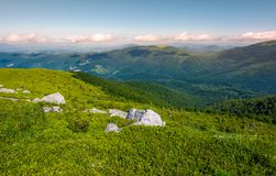 Grassy slopes of mountain ridge in afternoon. Grassy slopes and boulders of mountain ridge in afternoon. beautiful summer scenery of the Runa mountain of Royalty Free Stock Photos