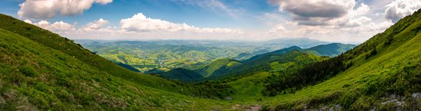 Grassy slopes of Pikui mountain. Amazing panorama with view to the valley and Borzhava ridge in a far distance. wonderful day to hike Royalty Free Stock Photography