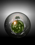 Grassy Sphere inside Glass Sphere royalty free stock photography