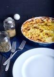 Gratén de la patata con crema, los huevos y el queso Imágenes de archivo libres de regalías