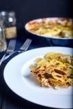 Gratén de la patata con crema, los huevos y el queso Fotografía de archivo