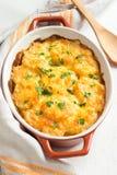 Gratén de la patata con queso Foto de archivo libre de regalías