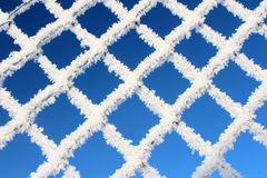 Grata congelata bianca su cielo blu Fotografia Stock