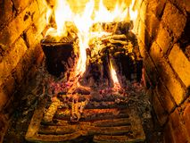 Grate and burning woods in fireplace royalty free stock image
