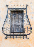 Grate of a covered window of an ancient Italian monastery Stock Image