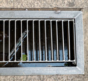 Grate covering, Sewer Storm water sump. On day Royalty Free Stock Photography