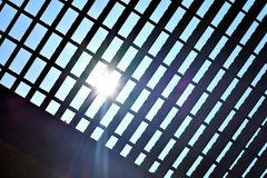 Grate. An old metal grate bridge from the bottom with sun shinning in Royalty Free Stock Images