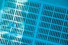 Grate over underwater pool drain. Diagonal view of underwater pool drain in clear blue water Stock Image