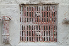 Grate and pipes on cement wall urban texture Stock Photo