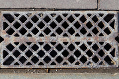Grate in the sidewalk Stock Photos