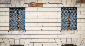 Grate of a window of an ancient Italian monastery. Royalty Free Stock Photo