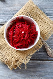 Grated beet red in a bowl on napkin Royalty Free Stock Image