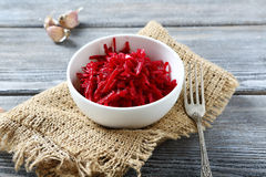 Grated beet salad in a bowl Stock Photos