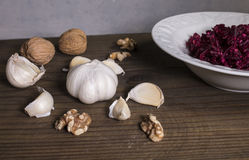 Grated beet salad, garlic, walnuts Royalty Free Stock Photo
