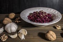 Grated beet salad, garlic, walnuts Stock Images
