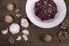 Grated beet salad, garlic, walnuts Stock Photos