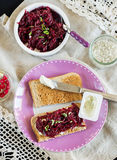 Grated beetroot with basil and goat's cheese on toast Royalty Free Stock Images