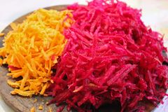 Grated beets and carrots. Background from grated beets and carrots. Grated vegetables. Food stock photo