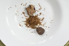 Grated black truffle. On white plate Royalty Free Stock Photography