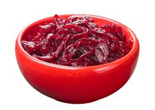 Grated boiled beet in a red cup Stock Photos