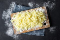 Grated boiled potatoes with flour for the preparation of an Italian dish - potato gnocchi royalty free stock photography