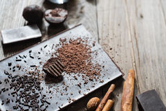 Grated cacao on top of chocolate bar Royalty Free Stock Images