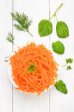Grated carrot in bowl, top view Stock Photography