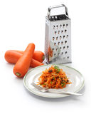 Grated carrot salad and grater Royalty Free Stock Image