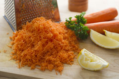 Grated Carrot. Sliced lemon and parsley stock photo