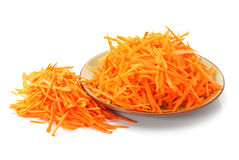 Grated carrot. On a white Stock Photo