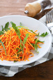 Grated carrots with arugula Stock Photos