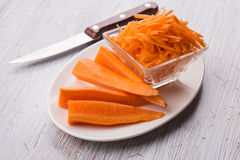 Grated carrots on board Royalty Free Stock Image