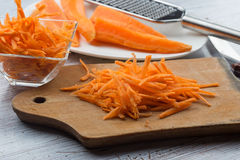 Grated carrots on board Stock Image