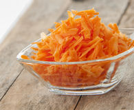 Grated carrots in bowl Royalty Free Stock Image