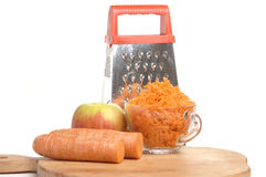 Grated carrots in a cup on a white background Stock Photo
