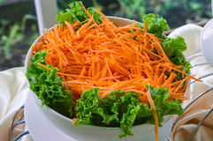 Grated carrots in a glass cup Stock Images
