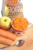 Grated Carrots In A Cup On A White Background Stock Images