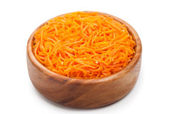 Grated carrots. Korean salad in wooden bowl. Royalty Free Stock Images