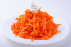 Grated carrots on plate Royalty Free Stock Photo