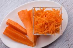 Grated carrots on plate Stock Image