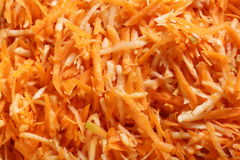 Grated carrots vegetables salad as background Stock Images