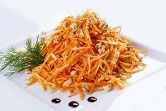 Grated carrots with walnuts. stock photo