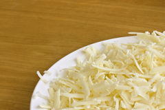 Grated cheddar cheese Royalty Free Stock Images