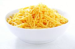 Grated cheddar cheese Royalty Free Stock Photos