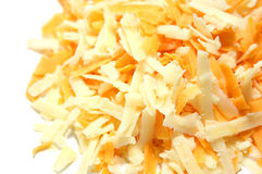 Grated Cheese. Grated Cheddar and Red Leicester cheeses, isolated on white Stock Photo