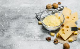 Grated cheese in a bowl with walnuts royalty free stock photos