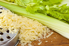 Grated Cheese with Celery Stock Photography