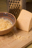 Grated cheese for cooking dishes Royalty Free Stock Photos